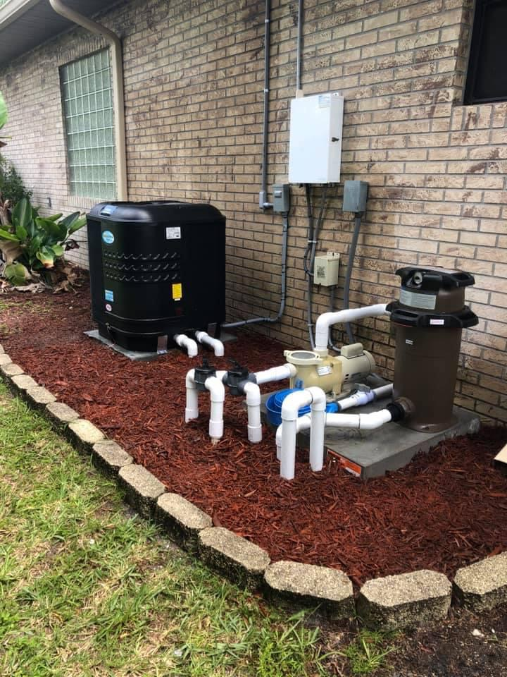 Aquatherm Heat Pump system installed with red mulch and pavers